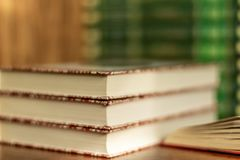 Open book and stacks of varied books many books piles on background with copyspace. Stack of varied books many books piles Education learning concept royalty free stock images
