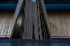 Open book stands on a glass table royalty free stock photos