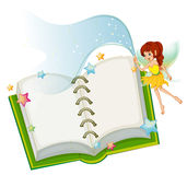 An open book with stars and a fairy Stock Images