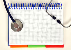 Open book and stethoscope Stock Images
