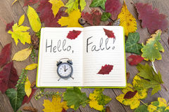 Open book surround by leafs with hello autumn sign Stock Photography
