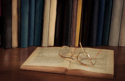 Open book on the table, glasses Stock Photo