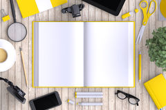 Open book on table with office objects and  blank modern devices. Stock Photos