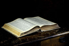 Open book on table. Old Holy Bible on table Stock Photography