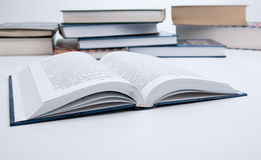 Open book on the table with other. Open book on white macro Stock Photo