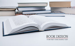 Open book on the table with other. Open book on white macro Stock Images