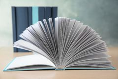 Open book on table. Open book on wooden table royalty free stock photo
