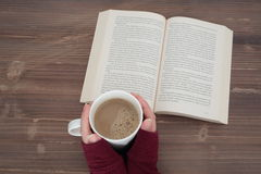 Open book on a table Royalty Free Stock Image