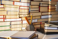 Open book, textbook, laptop, pencils in library, stack piles of literature text archive, bookshelves in school study class room ba royalty free stock photos