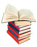 Open book on top of stack of books Royalty Free Stock Photos