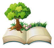 An open book with a tree royalty free illustration
