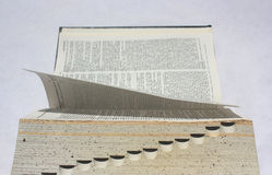 Open book - typwriter view. Leafing through a book -  book side view resembling the shape of typewriter Stock Images