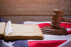 Open book on USA flag. Gavel near book and feather. You must know the law. Stay true to the order Royalty Free Stock Photo
