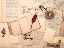 Open book, vintage accessories, letters, documents. Open book, vintage accessories, old letters and documents. sentimental nostalgic background royalty free stock photo
