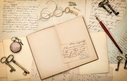 Open book, vintage accessories, old letters. Nostalgic paper bac Stock Photography