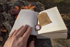 Open book with vintage bookmark stock photos