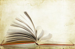 Open book - vintage photo. Vintage photo of open book on old paper background royalty free illustration