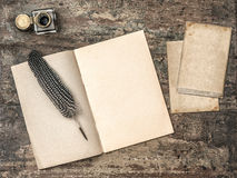Free Open Book, Vintage Writing Tools Feather Pen And Inkwell Stock Photo - 52809710