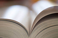 Open book on warm background Royalty Free Stock Image