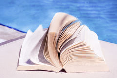 Open book on a water background Royalty Free Stock Photography