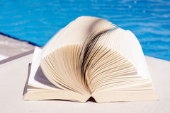 Open book on a water background Stock Images