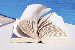 Open book on a water background Stock Photography