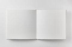 Open book on white background Stock Photos