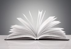 Open book on  white table. Open book open book background nobody paper closeup Royalty Free Stock Photography
