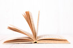 Open book on  white wood background Stock Photo