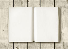 Open book on a white wood table Royalty Free Stock Images