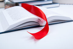 Open book whith red bookmark. Open book whith red ribbon bookmark Royalty Free Stock Photos
