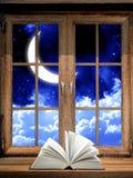 Open book on windowsill Stock Photography