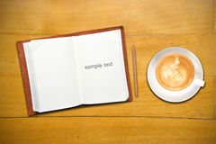Open Book With Cup Of Coffee Royalty Free Stock Photos