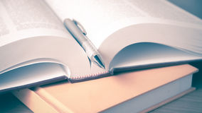 Open Book With Pen Stock Photo