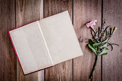 Open book on wood background Stock Photography