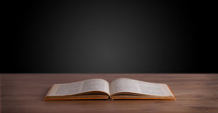 Open book on wooden deck Royalty Free Stock Images