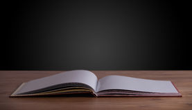 Open book on wooden deck Stock Images