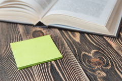 Open Book on Wooden Desk with Autumn Leaves Close up. Stock Photography