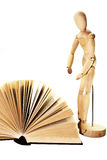 Open book and wooden dummy Stock Image