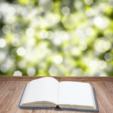 Open book on wooden planks Royalty Free Stock Image
