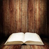 Open book with wooden table Royalty Free Stock Photo