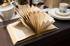 Open book. On wooden table stock images
