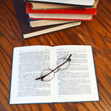 Open book on wooden table Royalty Free Stock Photography