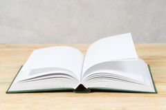 Open book on wooden table. Back to school. Copy space. Top view royalty free stock images