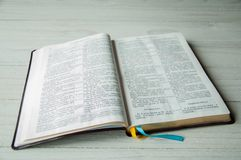 An open book on a wooden table. Bible on wooden background stock images