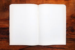 Open book on wooden table Stock Photography