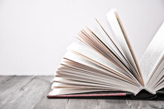 Open book on wooden table. Royalty Free Stock Images