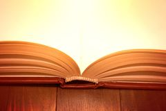 Open book on wooden table. Royalty Free Stock Photo