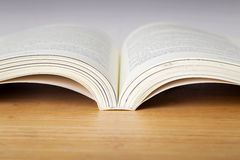 Open book on wooden  table. Stock Photography