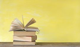 Open book on yellow background, free copy space Stock Photos